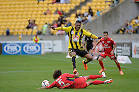 Kenny Cunningham and Osama Malik  during the A League - Wellington Phoenix v Adelaide United, Wellington, New Zealand on Sunday 30 March 2014. <br /> Photo by Masanori Udagawa. <br /> www.photowellington.photoshelter.com.