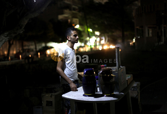 A Palestinian man sells coffee on a street in Gaza City, on Sept. 01, 2013. Photo by Ashraf Amra