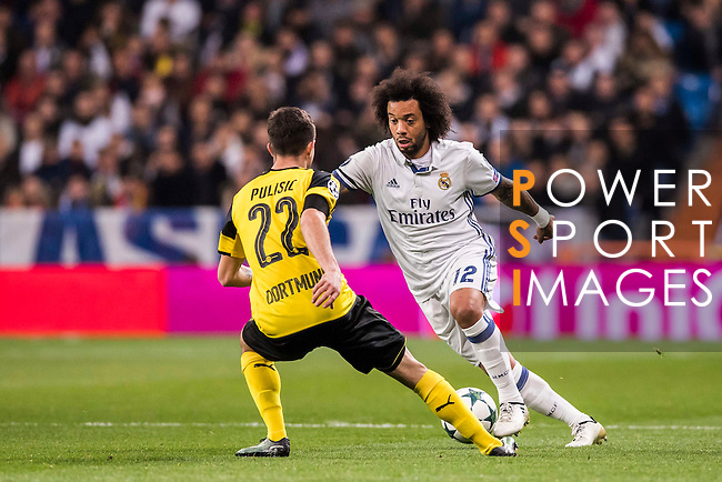 Marcelo Vieira Da Silva of Real Madrid competes for the ball with Christian Pulistic of Borussia Dortmund during the 2016-17 UEFA Champions League match between Real Madrid and Borussia Dortmund at the Santiago Bernabeu Stadium on 07 December 2016 in Madrid, Spain. Photo by Diego Gonzalez Souto / Power Sport Images