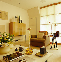 The living area is furnished with contemporary pieces and ceramics