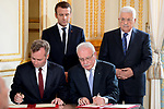 French Junior Foreign Affairs Minister Jean-Baptiste Lemoyne and Palestinian Foreign Minister Riyad Al-Maliki sign an agreement for the French International School in Ramallah as French President Emmanuel Macron and Palestinian President Mahmoud Abbas stand behind them ahead of a joint press conference following their meeting at the Elysee Palace in Paris, on July 5, 2017. Photo by Thaer Ganaim