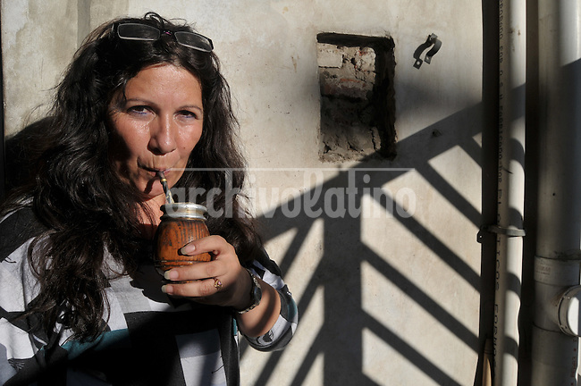 Alicia Romero, leader of Madres del Paco.drinks a mate, typical tea herb very popular in Argentina