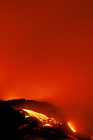 Hot molten lava makes its way to the sea on the Puna coast at Volcanoes National Park on the Big Island of Hawaii.