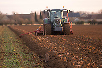 A Brown hare hides in front of a tractor and drill<br /> &copy;Tim Scrivener Photographer 07850 303986<br />      ....Covering Agriculture In The UK....