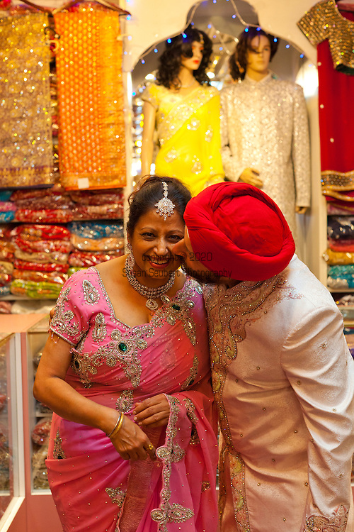 The Chandan Saree shop in the Geerrard India Bazaar, otherwise known as Little India.  Pictured here are Kuki and Sarbjeet Singh, both wearing traditional Indian party dress.