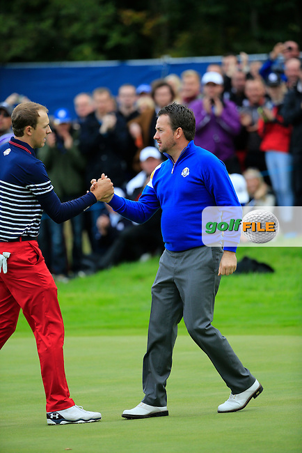 Graeme McDowell (EUR) shakes hands with Jordan Spieth (USA) on the 17th green after winning his match during the Sunday Singles Matches at the 2014 Ryder Cup at Gleneagles. The 40th Ryder Cup is being played over the PGA Centenary Course at The Gleneagles Hotel, Perthshire from 26th to 28th September 2014.: Picture Fran Caffrey, www.golffile.ie: \28/09/2014\