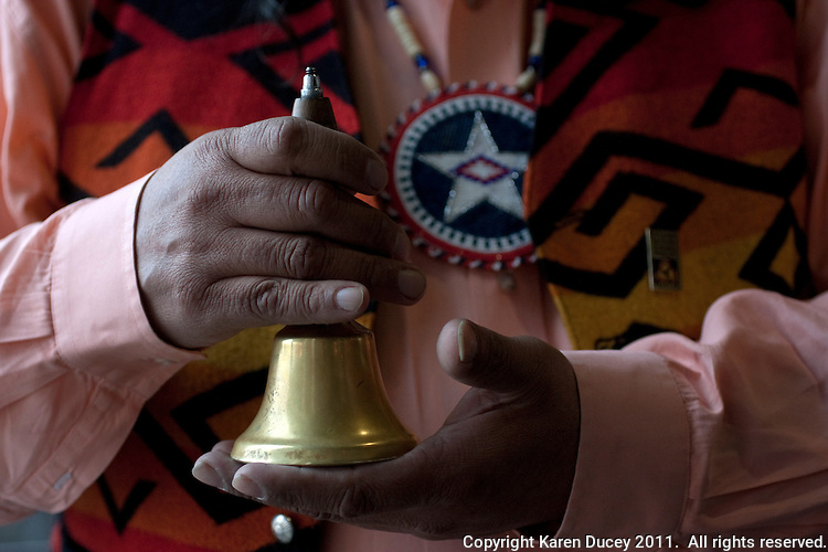 "Rex Buck Jr., leader of the Wanapum Indians holds a bell which he says represents the heartbeat of the people at the opening of an exhibit called ""Sacred Spaces"" at the Central Washington University Museum of Culture and Environment  in Ellensburg, Wash. on February 3, 2011.  (photo credit Karen Ducey)"