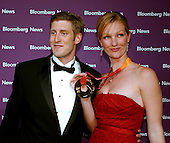 Eleanor Collins, right, makes a face for the cameras after her boyfriend Olympic Medalist Joey Cheek, left, put his Gold Medal around her neck as they arrived at the Embassy of the Republic of Macedonia in Washington, D.C. for the Bloomberg News party following the annual White House Correspondents Association (WHCA) dinner on April 29, 2006.<br /> Credit: Ron Sachs / CNP