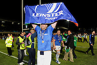 Jamie Heaslip of Leinster grabs a fan's flag after the Amlin Challenge Cup Final between Leinster Rugby and Stade Francais at the RDS Arena, Dublin on Friday 17th May 2013 (Photo by Rob Munro).