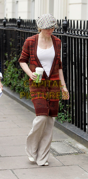 MADONNA.Leaves her new home in W1, London, England..September 5th, 2007 .full length beige trousers flat cap hat checkered red burgundy long sweater jumper jacket walking starbucks coffee cup drink.CAP/FIN.©Steve Finn/Capital Pictures