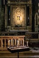 Alter with votive candles, San Lorenzo church, Porto Venere, Italy