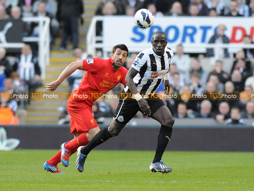 Newcastle United's Moussa Sissoko battles with José Enrique of Liverpool - Newcastle United vs Liverpool - Barclays Premier League Football at St James Park, Newcastle upon Tyne - 27/04/13 - MANDATORY CREDIT: Steven White/TGSPHOTO - Self billing applies where appropriate - 0845 094 6026 - contact@tgsphoto.co.uk - NO UNPAID USE