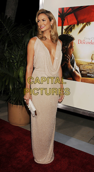 Stacy Keibler.Premiere of 'The Descendants' held at The Academy of Motion Pictures, Arts & Sciences in Beverly Hills, California, USA..November 15th, 2011.full length beige cream dress cowl neck low cut plunging neckline cleavage clutch bag white .CAP/ROT/TM.©Tony Michaels/Roth Stock/Capital Pictures