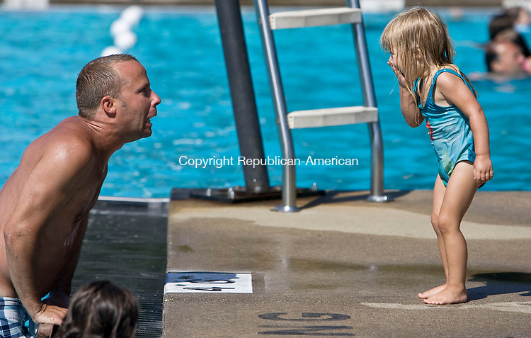 TORRINGTON, CT - 05 JULY 2010 -070510JT03-<br /> Madelyn Penny, 2, stifles a giggle as her father Bob makes faces at her at the Besse Pool in Torrington during Monday's heat.<br /> Josalee Thrift Republican-American