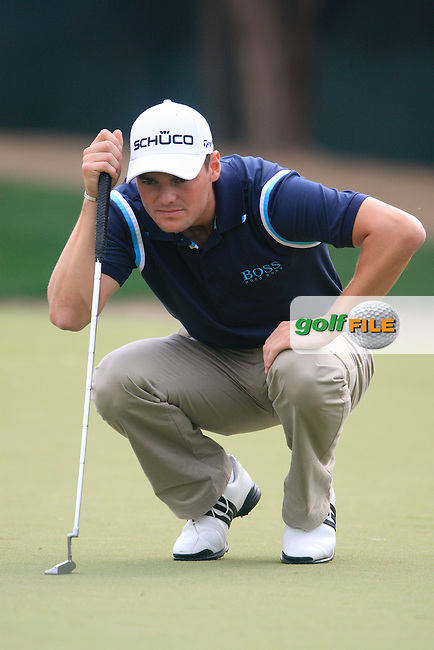 Martin Kaymer lines up his putt on the 11th green during Day 3 Saturday of the Abu Dhabi HSBC Golf Championship, 22nd January 2011..(Picture Eoin Clarke/www.golffile.ie)