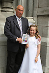 Holly Gary with her granddad Michael at the Scoil Aounghusa Communion 2011...(Photo credit should read Jenny Matthews www.newsfile.ie)....This Picture has been sent you under the conditions enclosed by:.Newsfile Ltd..The Studio,.Millmount Abbey,.Drogheda,.Co Meath..Ireland..Tel: +353(0)41-9871240.Fax: +353(0)41-9871260.GSM: +353(0)86-2500958.email: pictures@newsfile.ie.www.newsfile.ie.