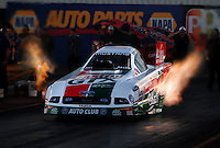 Jan 25, 2009; Chandler, AZ, USA; NHRA funny car driver John Force launches off the starting line during testing at the National Time Trials at Firebird International Raceway. Mandatory Credit: Mark J. Rebilas-