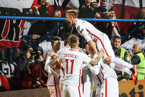 March 26th 2017, Podgorica City Stadium,  Montenegro; World Cup 2018 Internationl football qualification, Montenegro versus Poland;  Robert Lewandowski (POL)  goal celebration with Kamil Grosicki (POL), Michal Pazdan (POL), Jakub Blaszczykowski (POL)