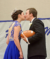 NWA Democrat-Gazette/BEN GOFF @NWABENGOFF<br /> Mackenzie Page, homecoming queen, gets a kiss from her escort and homecoming king Joseph Sultemeier after being crowned on Friday Sept. 18, 2015 during the homecoming ceremony at Rogers High School.
