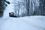 Snow plow on country road