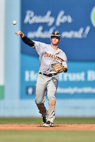 Charleston RiverDogs shortstop Kyle Holder (4) warms up between innings during game one of a double header against the Asheville Tourists at McCormick Field on July 8, 2016 in Asheville, North Carolina. The RiverDogs defeated the Tourists 10-4 in game one. (Tony Farlow/Four Seam Images)