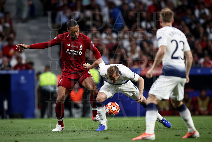 Tottenham Hotspur's Harry Kane, center, is challenged by Liverpool's Virgil van Dijk during the UEFA Champions League final football match between Tottenham Hotspur and Liverpool at Madrid's Wanda Metropolitano Stadium, Spain, June 1, 2019.<br /> UPDATE IMAGES PRESS/Isabella Bonotto