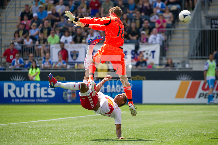 Juan Agudelo (17) of the New York Red Bulls goes up for a bicycle kick as Philadelphia Union goalkeeper Zac MacMath (18) defends. The New York Red Bulls defeated the Philadelphia Union  3-2 during a Major League Soccer (MLS) match at PPL Park in Chester, PA, on May 13, 2012.