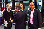 © Joel Goodman - 07973 332324 . 26/09/2016 . Liverpool , UK . SEUMAS MILNE (l) and CHUKA UMUNNA (r) pass one another after Umunna's appearance on Newsnight , watched from the background by Milne , at the ACC Conference Centre . Photo credit : Joel Goodman