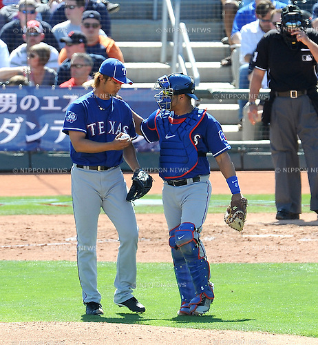 (L-R) Yu Darvish, Yorvit Torrealba (Rangers),.MARCH 13, 2012 - MLB :.Texas Rangers' pitcher Yu Darvish talks with catcher Yorvit Torrealba during a spring training game against the Cleveland Indians at Goodyear Ballpark in Goodyear, Arizona, United States. (Photo by AFLO)