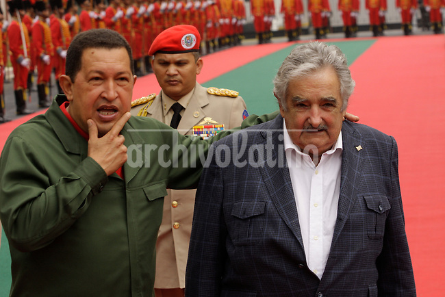 Presidents of Uruguay, Jose Mujica, and his counterpart of Venezuela, Hugo chavez, during a bilateral meeting at Miraflores Palace in Caracas, Venezuela
