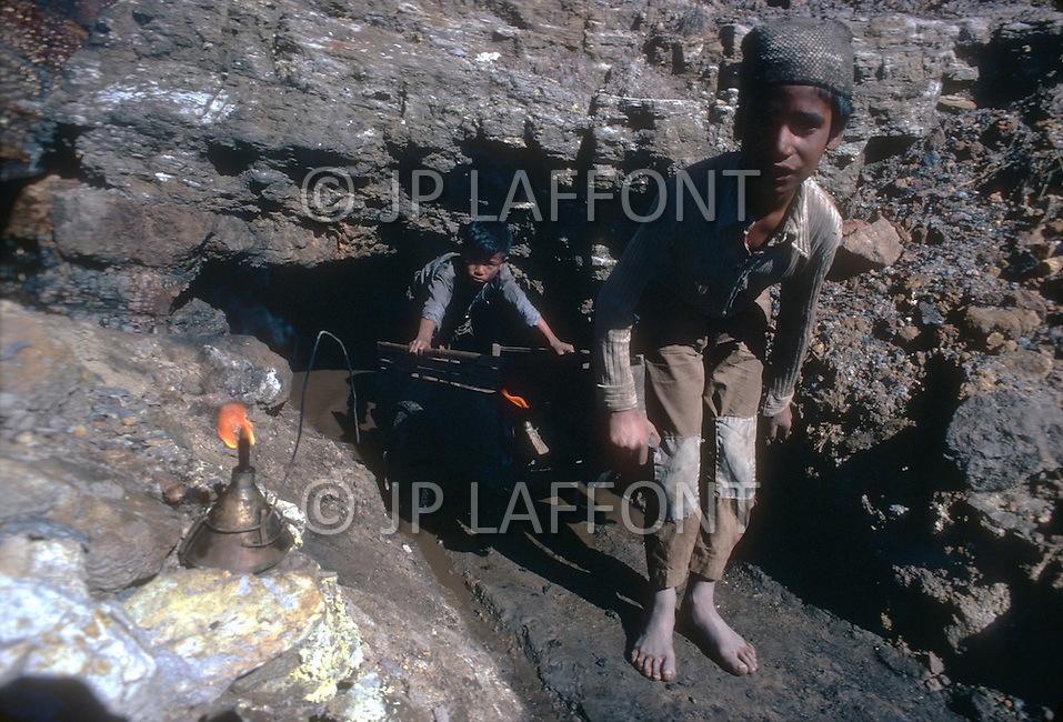 Children employed in the mining industry in India. - Child labor as seen around the world between 1979 and 1980 - Photographer Jean Pierre Laffont, touched by the suffering of child workers, chronicled their plight in 12 countries over the course of one year.  Laffont was awarded The World Press Award and Madeline Ross Award among many others for his work.