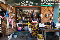 Hawa Edwards took a small loan from a microfinance program to build her general store business in Monrovia, Liberia. She makes about $100 per month and uses her profits to support her family.