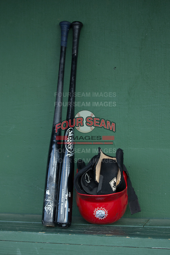 Hagerstown Suns equipment sits on the bench in the visitors dugout prior to the game against the Kannapolis Intimidators at Kannapolis Intimidators Stadium on May 6, 2016 in Kannapolis, North Carolina.  The Intimidators defeated the Suns 5-3.  (Brian Westerholt/Four Seam Images)