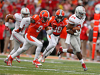 Ohio State Buckeyes running back Carlos Hyde (34) dodges Illinois Fighting Illini defensive back Earnest Thomas III (9) and Illinois Fighting Illini defensive back Jaylen Dunlap (28) during the second half of Saturday's NCAA Division I football game at Memorial Stadium in Champaign, Il., on November 16, 2013. Ohio State won the game 60-35. (Barbara J. Perenic/The Columbus Dispatch)