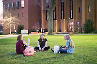 Students sitting on grass near McCool, enjoying mild temperatures: Delaney Gillespie (maroon), Giulia Hintz (black), Mary Anne Goolsby (grey).<br />  (photo by Megan Bean / &copy; Mississippi State University)
