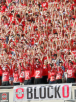 Ohio State Buckeyes Block O student section cheers after Ohio State Buckeyes quarterback Kenny Guiton (13) threw a touchdown pass in the 2nd quarter against San Diego State Aztecs in their college football game at Ohio Stadium in Columbus on September 7, 2013.  (Dispatch photo by Kyle Robertson)