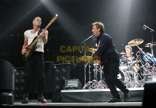 STING, ANDY SUMMERS & STEWART COPELAND - THE POLICE.Live during their 2007 Tour in Anaheim, California, USA.. June 21st, 2007                                                                    .**Editorial Use Only**.full length stage concert gig performance music drums gordon sumner bass white sleeveless top blue shirt guitar .CAP/EST.©Eastman/Capital Pictures