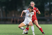 NEWTON, MA - AUGUST 29: Samantha Agresti #15 of Boston College attempts to control the ball as Julianna Sturema #18 of Boston University pressures during a game between Boston University and Boston College at Newton Campus Field on August 29, 2019 in Newton, Massachusetts.