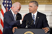 United States President Barack Obama delivers remarks at a tribute to US Vice President Joe Biden (L) during an event  in the State Dinning room of the White House, January 12, 2017 in Washington, DC. <br /> Credit: Olivier Douliery / Pool via CNP