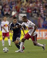 New York Red Bulls forward Juan Agudelo (17) dribbles as New England Revolution midfielder Benny Feilhaber (22) closes. In a Major League Soccer (MLS) match, the New England Revolution tied New York Red Bulls, 2-2, at Gillette Stadium on August 20, 2011.