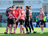Lincoln City players, from left, John Akinde, Harry Toffolo, Shay McCartan, and Harry Anderson with Lincoln City manager Danny Cowley at the end of the game<br /> <br /> Photographer Chris Vaughan/CameraSport<br /> <br /> The EFL Sky Bet League Two - Lincoln City v Cheltenham Town - Saturday 13th April 2019 - Sincil Bank - Lincoln<br /> <br /> World Copyright &copy; 2019 CameraSport. All rights reserved. 43 Linden Ave. Countesthorpe. Leicester. England. LE8 5PG - Tel: +44 (0) 116 277 4147 - admin@camerasport.com - www.camerasport.com