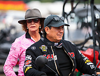 Aug 19, 2018; Brainerd, MN, USA; NHRA top fuel driver Billy Torrence with wife Kay Torrence during the Lucas Oil Nationals at Brainerd International Raceway. Mandatory Credit: Mark J. Rebilas-USA TODAY Sports
