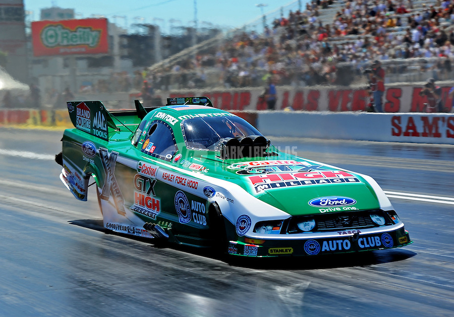 Apr. 1, 2011; Las Vegas, NV, USA: NHRA funny car driver John Force during qualifying for the Summitracing.com Nationals at The Strip in Las Vegas. Mandatory Credit: Mark J. Rebilas-