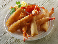 chinese starters - deep fried breaded prawns. spring rolls, dim sum, and samosas