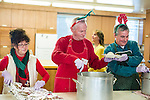 Waterbury, CT- 25 December 2016-122516CM05- Husband and wife, Lorraine Brandolini and Ed Clark, serve up meals along with fellow volunteer Rob Goldberg of Waterbury during a Joy of Christmas Dinner at the First Congregational Church in Waterbury.     Christopher Massa Republican-American