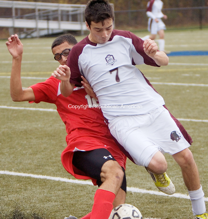 WATERBURY, CT. 26 October 2012-102712SV10-#12 Mike Bozzutto of Wolcott High and #7 Shane Bierfeldt of Torrington High battle for the ball during NVL Soccer Tournament action in Waterbury Saturday..Steven Valenti Republican-American