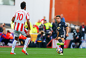 9th September 2017, bet365 Stadium, Stoke-on-Trent, England; EPL Premier League football, Stoke City versus Manchester United; Ander Herrera of Manchester United passes the ball and is watched by Eric Maxim Choupo-Moting of Stoke City