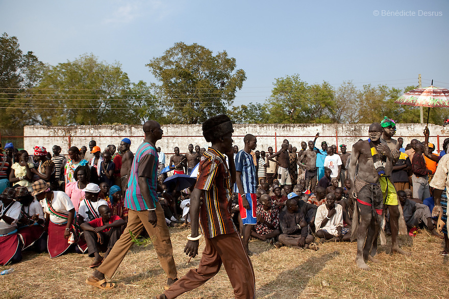 Sunday 5 december 2010 - Juba, Southern Sudan - Dinka wrestlers team and Dinka tribe before the match. Traditional wrestling matches in Juba Stadium between Dinka wrestlers from Yirol East of Lake State and Mundari wrestlers from Terekeka County of Central Equatoria State. The matches attracted large numbers of spectators who sang, played drums and danced in support of their favorite wrestlers. The match organizers hoped that the sport would bring together South Sudan's many different tribes.Photo credit: Benedicte Desrus