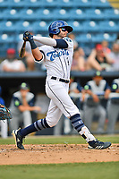 Asheville Tourists Cade Harris (4) swings at a pitch during a game against the Columbia Fireflies at McCormick Field on June 23, 2019 in Asheville, North Carolina. The Fireflies defeated the Tourists 11-9. (Tony Farlow/Four Seam Images)