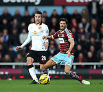 West Ham's James Tomkins tussles with Manchester United's Robin Van Persie<br /> <br /> Barclays Premier League- West Ham United vs Manchester United  - Upton Park - England - 8th February 2015 - Picture David Klein/Sportimage